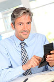 Manager in office calculating budget — Stock Photo