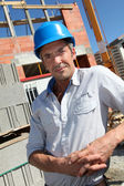 Portrait of construction worker with security helmet — Stock Photo