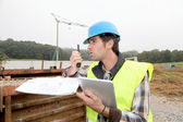 Foreman on building site with walkie-talkie — Stock Photo