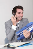 Salesman having bunch of work — Stock Photo