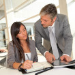 Foto Stock: Manager and businesswoman meeting in office