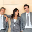 Business team standing in hall — Stock Photo
