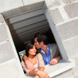 Stock Photo: In loved couple standing in their future house
