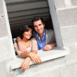 In loved couple standing in their future house — Stock Photo #18261417