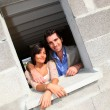 In loved couple standing in their future house — Stock Photo #18261433