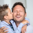 Little bond boy giving a kiss to his dad - Foto de Stock