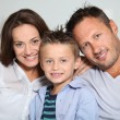 Closeup of parents and child relaxing at home on sofa — Stock Photo