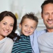 Closeup of parents and child relaxing at home on sofa — Stock Photo #18262493