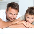 Closeup of father and son at home — Stock Photo #18262639