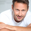 Man with arms crossed looking at camera — Stock Photo