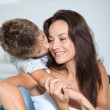 Royalty-Free Stock Photo: Little boy kissing her mom
