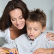 Mother and child doing homework - Stock Photo