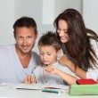 Stock Photo: Parents helping son to do his homework
