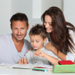 Parents helping son to do his homework — Stock Photo