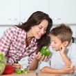 Mother cooking with son in kitchen — Stock Photo #18263067