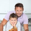Father and son fixing dinner — Stock Photo