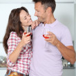 Stock Photo: Couple drinking wine while fixing dinner