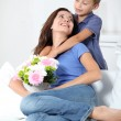 Little boy giving flowers to his mom on mother's day — Stock Photo #18263343
