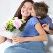 Little boy kissing his mom on mother's day — Foto Stock