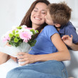 Stockfoto: Little boy kissing his mom on mother's day