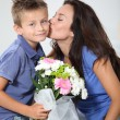 Little boy giving flowers to his mom on mother's day — Stock Photo #18263393