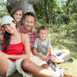 Family sitting in nature on a hiking day — Stock Photo