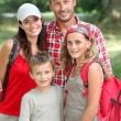Happy family portrait on a hiking day — Stock Photo