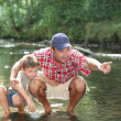 Father showing the river to his son - Stock Photo