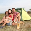 Parents and children in camp tent — Stock Photo #18263805