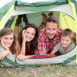 Parents and children in camp tent — Foto Stock