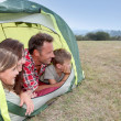 Foto de Stock  : Parents and children in camp tent
