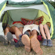 View of feet from outside a camp tent — Stock Photo #18263879
