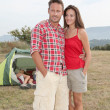 Couple standing in front of camping tent — Stock Photo