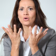 Businesswoman with misunderstanding look — Stock Photo