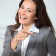 Businesswompointing at camera — Stock Photo #18264275