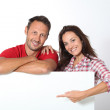 Couple showing white board for message — Stock Photo