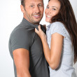 Woman pulling on her boyfriend neck — Stock Photo #18264827