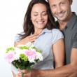 Man giving bunch of flowers to girlfriends — Stock Photo #18264839
