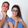 Couple wearing colored glasses having fun — Stock Photo #18264861