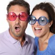 Couple wearing colored glasses having fun — Stock Photo #18264873