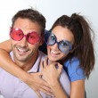Couple wearing colored glasses having fun — Stock Photo #18264881