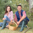 Couple in forest picking mushrooms in autumn — Stock Photo #18265043