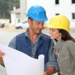 Team of architects checking plans on site — Stock Photo #18265139