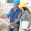 Team of architects checking plans on site — Stock Photo