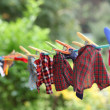 Doll clothes drying on clothes line - Stock Photo