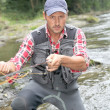 Fisherman in river with fly fishing rod — Stock Photo #18265267