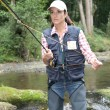 Womwith fly fishing rod in river — Stok Fotoğraf #18265273