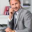 Closeup of businessman at his desk — Stock Photo #18265329