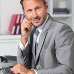 Closeup of businessman at his desk — Stock Photo