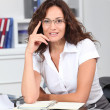 Closeup of smiling businesswoman wearing eyeglasses — Stock Photo